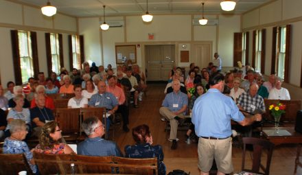 A group of people meeting in Grange Hall